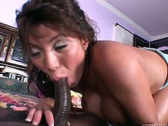 Attractive Japanese babe with nice body gets her cunt licked and blows a cock in 69 pose.