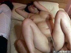 The horny chubby wife Rin Aoki enjoys the thrill of getting her yummy hairy pussy drilled next to her sleeping husband who could wake up any moment.