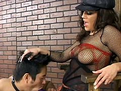 Sexy brunette mistress Michelle Avanti is having fun with a nerd indoors. Michelle pounds the man's butt with a toy and enjoys the way he moans.