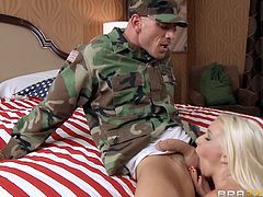 This sexy blonde bitch has just arrived overseas as part of a USO tour, and today she is going to show how much the American troops mean to her. She finds one of the privates and sucks his cock in his army barracks. She looks so hot in her USA bikini and top hat. She is one sexy Uncle Sam! She even has booze poured on her boobs.