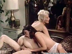 The Classic Porn brings you an amazing free porn video where you can see how a blonde and a brunette retro slut share a hard cock and also go lesbo on each other.