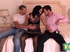 Sonia leaves only her thigh high stockings on while she rides one guy's hard cock while leaning over and sucking the other guy off.