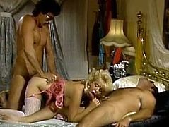 Skilled retro blonde gives blowjob and gets her appetizing ass fucked doggy style. She is everything your lust desires. Just enjoy watching her for free.