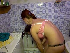 Horny mature amateur lady gets really turned on as she gets a bath from the sexiest teen and they both end up rubbing their hot pussies.