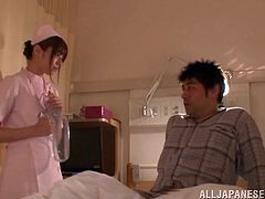 Take a look at this hot scene where the slutty nurse Rina Rukawa jerks a patient's hard cock before sucking him and ending up with a facial.