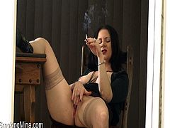 Make sure you take a look at this hot solo video where this horny brunette plays with her pink shaved pussy while having a smoke.