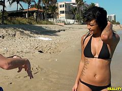 Sexy ebony chick Harley Dean, wearing a bikini, is having fun with a man on a beach. After that they go to a bedroom and fuck in the reverse cowgirl position and doggy style there.