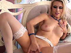 Check out this great solo scene where the beautiful blonde Michelle Moist wears lingerie as she plays with her pink pussy.