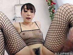 Check out this hot scene where the sexy oiled up Hitomi Fujiwar jerks and rides a hard cock while wearing full body fishnet lingerie.