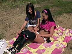 Get a hard dick by watching these brunette teens, with natural tits and smooth pink pearls, while they lick and touch each other outdoors.