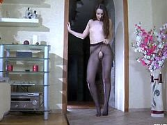 Crystal is a lovely brunette with long legs who is in love with pantyhose. She puts a sexy, black pair on and then she rips them off in the pussy area, posing further.