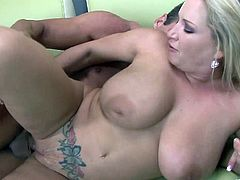 A pretty, blonde cougar with big tits and a great ass enjoys an awesome missionary style fuck. Hear her scream with pleasure now!