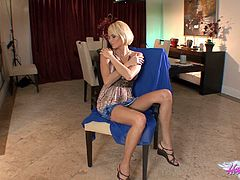 Check out Hanna Hilton's incredible body in this solo scene where you'll see her taking off her dress to play with her shaved cunt.
