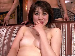 Horny Japanese woman is playing dirty games with many men in the living room. She plays with the dudes' wangs and enjoys heavy pounding in the standing and other positions.