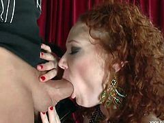 Share this with your friends! A redhead MILF, with natural jugs and a shaved pussy, while she goes hardcore and moans like a bitch.