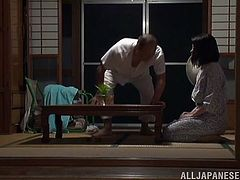 Curvy Japanese wife Honami Uehara is having fun with her hubby indoors. She lets the guy play with her big natural tits, then they fuck in the missionary and other positions.