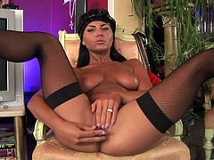 Witness this clip where a brunette doll, with natural breasts wearing nylon stockings, while she masturbates ardently until she has an orgasm.