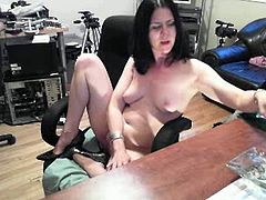Sexy brunette MILF gets turned on in the office and gets down for some sexy fingering before shoving a big dildo up her hot pussy.