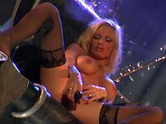 Gorgeous busty blonde Mandy Bright, wearing a fishnet top, is having some good time alone. She fondles her amazing body ardently and drills her coochie with a vibrator.