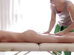 Sexy Nina lays boobs down on the massage therapists table as he rubs her back