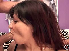 This busty granny is from Europe and she is slutty. She lets two young guys to fuck her face and play with her big boobs as they please. She enjoys it a lot.