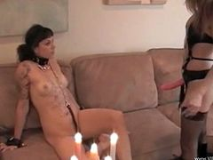 Lascivious dark-haired wench gets her ass spanked and provides blondie with awesome cunnilingus. Then she gets her snatch straponed doggystyle and sucks that strapon.