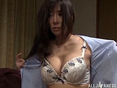 Check out this hot scene where this Japanese milf sucks on this guy's hard cock until making him cum after she takes off her clothes.