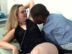 The gorgeous Tera Knightly wears her sexy glasses while she gives this horny black guy an amazing handjob and footjob to milk his cock.