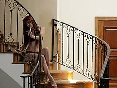 Red head teen  Elle Alexandra masturbates her wet pussy by the stairs. This young spunk hungry whore is on her way to the most amazing things she can think of on her own.