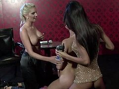 Sexy babes Zuzana Z, Nessa Devil and Eliska, wearing glamour outfits, are having a nice time together. The girls caress each other tenderly, then finger and toy one another's shaved coochies.