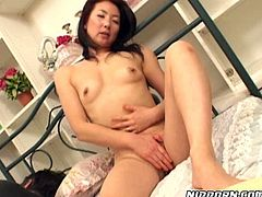 Horny Asian housewife masturbates while her husband is sleeping
