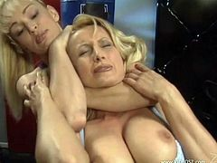 Share this with your friends! Two blonde MILFs, with big jugs wearing sportive clothes, have a catfight and end up touching each other sexually.