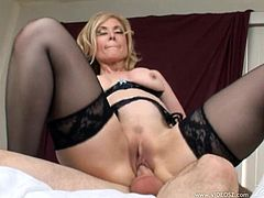 The gorgeous MILF Nina Hartley wears her sexy black stockings as she gets her yummy pussy licked and rammed hard by a horny dude.