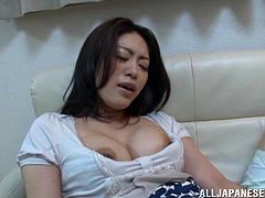 Take a nice look at this Japanese lady, with natural jugs wearing cute panties, while she touches herself and plays with a big toy.