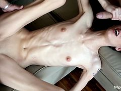 Share this with your friends! A brunette babe, with a nice ass wearing panties, goes hardcore with two guys in a crazy threesome over a couch.