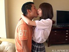 A pretty Japanese babe in a college uniform gets her juicy tits licked. Rei also give a nice blowjob and gets fucked on a sofa.
