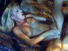 Horny blonde lesbians Tanya Danielle and Zora Banx are getting naughty in a bedroom. They lick and rub each other's smooth pussies, then fuck them with dildos and strapons.
