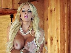 Watch the beautiful blonde Nicolette Shea taking off her lingerie in this solo scene where you'll see her wearing nothing more than just her high heels.