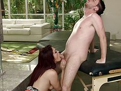The gorgeous redhead MILF GI Jen gives Dane Cross an amazingly sexy massage and ends up getting a big cumshot after a hot blowjob.