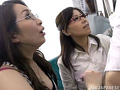 This gorgeous Japanese babes in glasses enjoy sucking some hard tasty cocks in the city bus where everyone can see them.