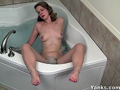Carmen sits in the bathtub naked and turns on the hydro-massage function. She positions her pussy there and enjoys all the nice sensations from the water jet.