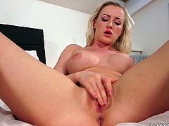 A vivacious young blonde with long hair, big tits and a hot ass enjoys licking and sucking a stranger's huge cock on her bed.