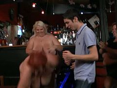 These three skanks from Europe turned a bar into a strip club. They stripped off their clothes and showed off their massive jugs and their generous curves.