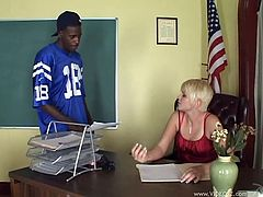 Touch yourself as you watch this short haired teacher, with big knockers wearing a miniskirt, while she goes hardcore with a black fellow.