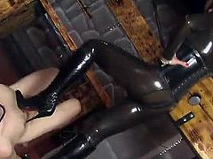 Mistress Ella Kross is dressed in latex from head to toe. She wants her slave to clean her boots with his tongue and he obeys. Next, she steps on his chest and cock.
