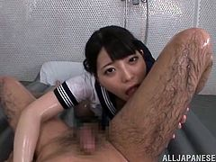 Get a boner watching this Japanese brunette, with a nice ass wearing her uniform, while she goes hardcore with a horny dude covered in oil.