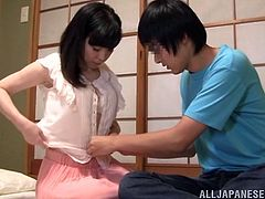 Entertain yourself by watching this Asian brunette, with natural boobs wearing a miniskirt, while she gets fucked hard in a reality video.