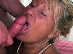 Take a nice look at this blonde mature lady, with big knocker and a shaved pussy, while she gets fucked hard by naughty dude over a bed.