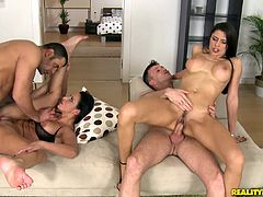 Alluring brunette Martina Gold, wearing jeans, and her awesome GF are having a great time with two studs. The tarts favour the men with blowjobs, then ride their schlongs crazily.