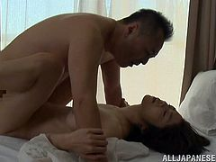 Beautiful Japanese wife spreads her legs wide apart and lets her man eat her coochie. After that they have sex in the missionary position.